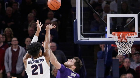 <p>               Gonzaga forward Rui Hachimura (21) shoots the go-ahead basket while defended by Washington forward Sam Timmins (33) during the second half of an NCAA college basketball game in Spokane, Wash., Wednesday, Dec. 5, 2018. Gonzaga won 81-79. (AP Photo/Young Kwak)             </p>