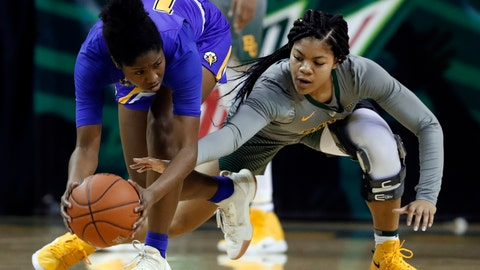 <p>               Morehead State forward McKenzie Calvert (12) keeps the ball out of reach as Baylor guard Trinity Oliver, right, attempts a steal in the second half of an NCAA college basketball game, Wednesday, Dec. 12, 2018, in Waco, Texas. (AP Photo/Tony Gutierrez)             </p>