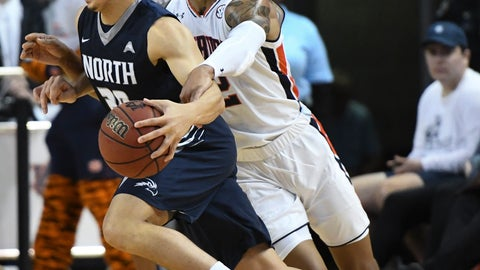 <p>               Auburn guard Bryce Brown (2) fouls North Florida guard Brian Coffey II (20) during the first half of an NCAA college basketball game Saturday, Dec. 29, 2018, in Auburn, Ala. (AP Photo/Julie Bennett)             </p>