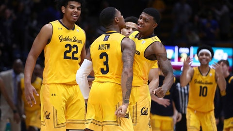 <p>               California's Paris Austin (3) celebrates with Darius McNeill, right, and Andre Kelly (22) after making the game winning score against Cal Poly in the second half of an NCAA college basketball game Saturday, Dec. 15, 2018, in Berkeley, Calif. (AP Photo/Ben Margot)             </p>