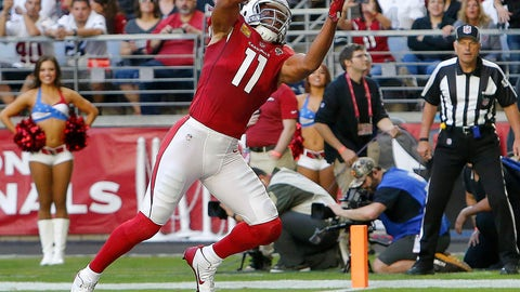 <p>               FILE - In this Nov. 18, 2018, Arizona Cardinals wide receiver Larry Fitzgerald (11) pulls in a touchdown catch against the Oakland Raiders during the first half of an NFL football game in Glendale, Ariz. Fitzgerald needs one catch to pass Jerry Rice for most catches for one team in NFL history. (AP Photo/Rick Scuteri, File)             </p>