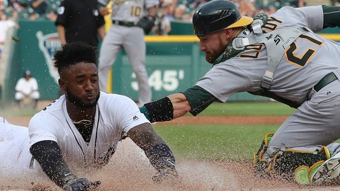 <p>               FILE - In this June 26, 2018, file photo, Detroit Tigers shortstop Niko Goodrum beats the tag of Oakland Athletics catcher Jonathan Lucroy during the first inning of a baseball game in Detroit. A person with knowledge of the agreement says Lucroy has agreed to join the Los Angeles Angels. The person spoke to The Associated Press on condition of anonymity Friday, Dec. 28, because the deal has not been announced by the Angels, who had no accomplished big-league catchers on their 40-man roster. (AP Photo/Carlos Osorio, File)             </p>