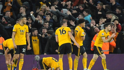 <p>               Wolverhampton Wanderers players celebrate after Diogo Jota scored his side's second goal during the English Premier League soccer match between Wolverhampton Wanderers and Chelsea at the Molineux Stadium in Wolverhampton, England, Wednesday, Dec. 5, 2018. (AP Photo/Rui Vieira)             </p>