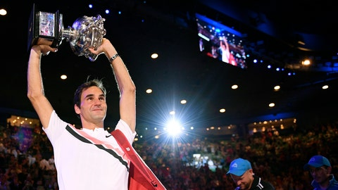 <p>               Switzerland's Roger Federer holds his trophy aloft after defeating Croatia's Marin Cilic during the men's singles final at the Australian Open tennis championships in Melbourne, Australia, Sunday, Jan. 28, 2018. (AP Photo/Andy Brownbill)             </p>