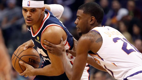 <p>               Los Angeles Clippers forward Tobias Harris, left, looks to pass as Phoenix Suns forward Josh Jackson (20) defends during the first half of an NBA basketball game, Monday, Dec. 10, 2018, in Phoenix. (AP Photo/Matt York)             </p>