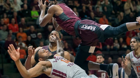 <p>               Maryland-Eastern Shore guard Canaan Bartley (3) charges over Virginia Tech forward P.J. Horne (14) during the first half of an NCAA college basketball game Friday, Dec. 28, 2018, in Blacksburg, Va. (AP Photo/Don Petersen)             </p>