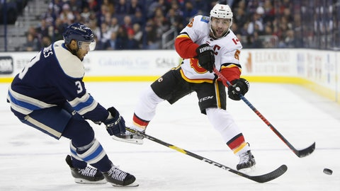<p>               Calgary Flames' Mark Giordano, right, dumps the puck past Columbus Blue Jackets' Seth Jones during the first period of an NHL hockey game Tuesday, Dec. 4, 2018, in Columbus, Ohio. (AP Photo/Jay LaPrete)             </p>