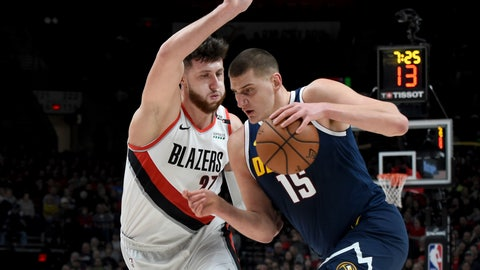 <p>               Denver Nuggets center Nikola Jokic, right, drives to the basket on Portland Trail Blazers center Jusuf Nurkic during the first half of an NBA basketball game in Portland, Ore., Friday, Nov. 30, 2018. (AP Photo/Steve Dykes)             </p>