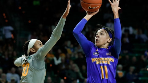 <p>               Baylor's Juicy Landrum (20) defends against a shot by Morehead State guard Miranda Crockett (11) in the first half of an NCAA college basketball game, Wednesday, Dec. 12, 2018, in Waco, Texas. (AP Photo/Tony Gutierrez)             </p>