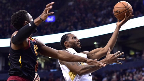 <p>               Toronto Raptors forward Kawhi Leonard, right, drives to the basket as Cleveland Cavaliers guard Rodney Hood, left, defends during second-half NBA basketball game action in Toronto, Friday, Dec. 21, 2018. (Frank Gunn/The Canadian Press via AP)             </p>