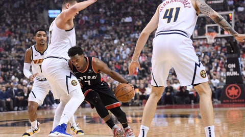 <p>               Toronto Raptors guard Kyle Lowry (7) drives between Denver Nuggets centre Nikola Jokic (15) and Nuggets forward Juan Hernangomez (41) during first half NBA basketball action in Toronto on Monday, Dec. 3, 2018. (Nathan Denette/The Canadian Press via AP)             </p>