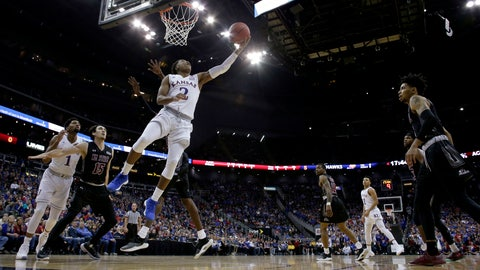 <p>               Kansas' Charlie Moore (2) shoots during the first half of the team's NCAA college basketball game against New Mexico State on Saturday, Dec. 8, 2018, in Kansas City, Mo. (AP Photo/Charlie Riedel)             </p>