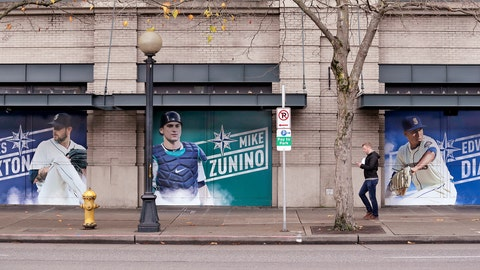 <p>               In this photo taken Thursday, Nov. 29, 2018, oversized photos of Seattle Mariners recently-traded players pitcher James Paxton, left, catcher Mike Zunino, and closer Edwin Diaz stand along a sidewalk at the team's ballpark, in Seattle. Paxton was traded to the New York Yankees and Zunino to the Tampa Bay Rays in November and Diaz was traded to the New York Mets in a deal announced Monday, Dec. 3, 2018. (AP Photo/Elaine Thompson)             </p>