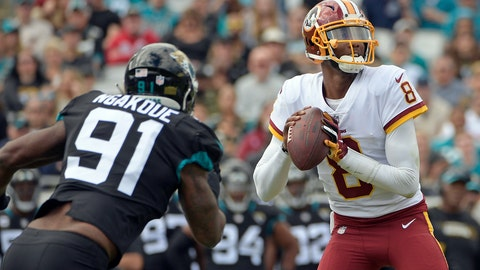 <p>               Washington Redskins quarterback Josh Johnson (8) looks for a receiver as he is pressured by Jacksonville Jaguars defensive end Yannick Ngakoue (91) during the first half of an NFL football game, Sunday, Dec. 16, 2018, in Jacksonville, Fla. (AP Photo/Phelan M. Ebenhack)             </p>
