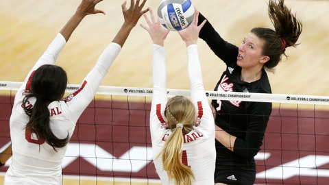 <p>               Nebraska's Mikaela Foecke (2) hits on the block of Stanford's Tami Alade (8) and Jenna Gray (1) in the first set of the championship match of the NCAA Div I Women's Volleyball Championships, Saturday, Dec. 15, 2018, in Minneapolis. (AP Photo/Andy Clayton-King)             </p>