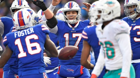 <p>               Buffalo Bills quarterback Josh Allen (17) celebrates after running back LeSean McCoy scored a 5-yard touchdown during the second half of an NFL football game against the Miami Dolphins, Sunday, Dec. 30, 2018, in Orchard Park, N.Y. (AP Photo/Adrian Kraus)             </p>