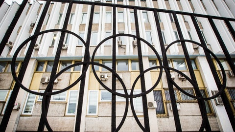 <p>               FILE - In this Dec. 6, 2017, file photo, the building of the Russian Olympic Committee is seen through a gate decorated with the Olympic rings, in Moscow, Russia. Two senators have introduced a bill that would criminalize international doping conspiracies, the likes of which Russia pursued during the Sochi Olympics in 2014. The measure is named after Grigory Rodchenkov, the Moscow lab director who blew the whistle on Russian cheating. (AP Photo/Alexander Zemlianichenko, File)             </p>