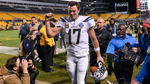 <p>               Photographers surround Los Angeles Chargers quarterback Philip Rivers (17) as he leaves the field after defeating the Pittsburgh Steelers 33-30 in an NFL football game, Sunday, Dec. 2, 2018, in Pittsburgh. (AP Photo/Don Wright)             </p>