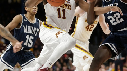 <p>               Minnesota guard Isaiah Washington (11) drives to the basket against Mount St. Mary's forward Nana Opoku (22) during the first half of an NCAA basketball game Sunday, Dec. 30, 2018, in Minneapolis. (AP Photo/Paul Battaglia)             </p>