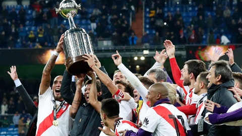 <p>               Marcelo Gallardo, coach of Argentina's River Plate, second from left, celebrates with the trophy after his team defeated Argentina's Boca Juniors to win the Copa Libertadores final soccer match at Santiago Bernabeu stadium in Madrid, Spain, Sunday, Dec. 9, 2018. (AP Photo/Manu Fernandez)             </p>