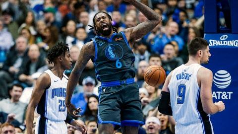 <p>               Dallas Mavericks forward DeAndre Jordan (6) celebrates a dunk as Orlando Magic forwards Wesley Iwundu (25) and Nikola Vucevic (9) look on during the first half of an NBA basketball game, Monday, Dec. 10, 2018, in Dallas. (AP Photo/Brandon Wade)             </p>