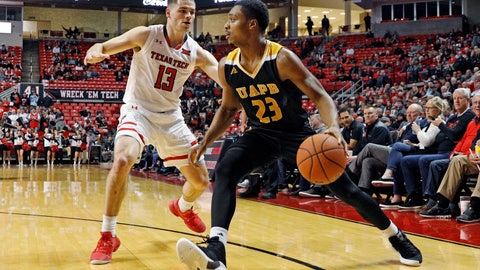 <p>               Arkansas-Pine Bluff's Martaveous McKnight (23) drives the ball around Texas Tech's Matt Mooney (13) during the first half of an NCAA college basketball game, Wednesday, Dec. 5, 2018, in Lubbock, Texas. (AP Photo/Brad Tollefson)             </p>