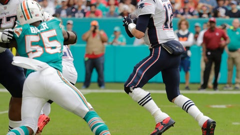 <p>               THIS CORRECTS THE IDENTIFICATION OF THE PATRIOTS PLAYER SHOWN TO QUARTERBACK TOM BRADY, AND NOT JULIAN EDELMAN -  New England Patriots quarterback Tom Brady gets ready to throw a touchdown pass to wide receiver Julian Edelman (not shown), during the first half of an NFL football game against the Miami Dolphins, Sunday, Dec. 9, 2018, in Miami Gardens, Fla. (AP Photo/Lynne Sladky)             </p>