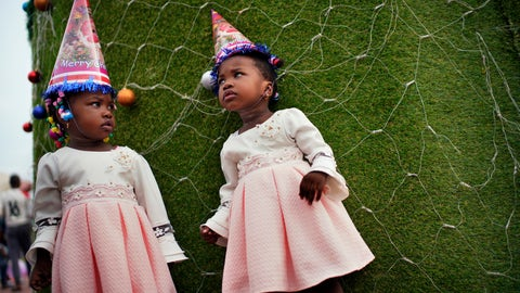 <p>               Twins pose for a photograph in Kinshasa, Congo, on Tuesday Dec. 25, 2018. People dress up and take to the parks on Christmas Day, this time five days before scheduled presidential and general elections. (AP Photo/Jerome Delay)             </p>