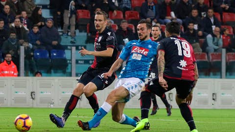 <p>               Napoli's Fabian Ruiz, center, shoots the ball during the Italian Serie A soccer match between Cagliari and Napoli at the Sardegna Arena stadium in Cagliari, Italy, Sunday, Dec. 16, 2018. (Fabio Murru/ANSA via AP)             </p>