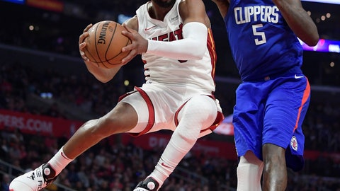 <p>               Miami Heat guard Dwyane Wade, left, passes the ball as Los Angeles Clippers forward Montrezl Harrell defends during the second half of an NBA basketball game, Saturday, Dec. 8, 2018, in Los Angeles. The Heat won 121-98. (AP Photo/Mark J. Terrill)             </p>