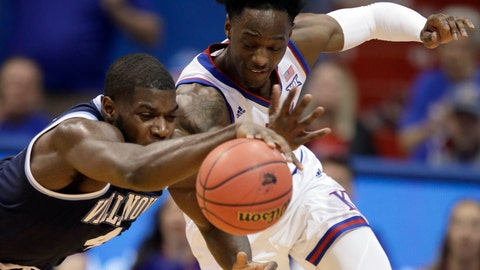 <p>               Villanova forward Eric Paschall (4) and Kansas guard Marcus Garrett, right, race for the ball during the first half of an NCAA college basketball game in Lawrence, Kan., Saturday, Dec. 15, 2018. (AP Photo/Orlin Wagner)             </p>
