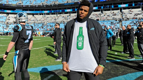 <p>               Carolina Panthers' Cam Newton shows off the t-shirt in support of starting quarterback Taylor Heinicke before an NFL football game against the Atlanta Falcons in Charlotte, N.C., Sunday, Dec. 23, 2018. Newton has been benched for Heinicke so he can rest his injured shoulder. (AP Photo/Mike McCarn)             </p>