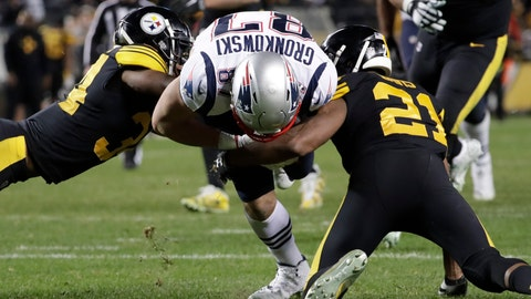 <p>               New England Patriots tight end Rob Gronkowski (87) is tackled by Pittsburgh Steelers free safety Sean Davis (21) and Coty Sensabaugh (24) during the second half of an NFL football game in Pittsburgh, Sunday, Dec. 16, 2018. (AP Photo/Don Wright)             </p>