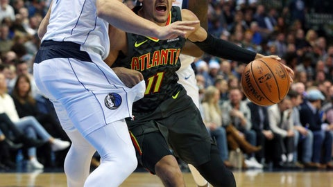 <p>               Atlanta Hawks guard Trae Young (11) tries to drive past Dallas Mavericks forward Dwight Powell (7) in the first half of an NBA basketball game Wednesday, Dec. 12, 2018, in Dallas. (AP Photo/Richard W. Rodriguez)             </p>
