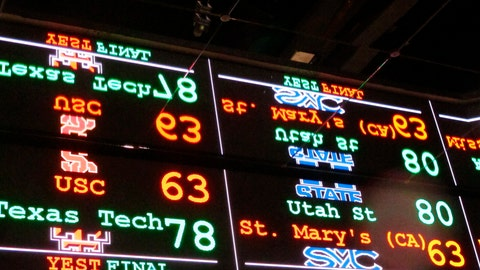 <p>               This Nov. 20, 2018 photo shows a scrolling video board with basketball scores reflected in the ceiling of the new sports book at Resorts Casino in Atlantic City, N.J. Figures released on Dec 12, 2018 show New Jersey's sports betting market is closing in on the $1 billion mark, with about $928 million having been wagered in less than six months of operation. (AP Photo/Wayne Parry)             </p>