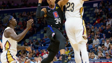 <p>               Los Angeles Clippers forward Tobias Harris (34) passes around New Orleans Pelicans forward Anthony Davis (23) and guard Jrue Holiday (11) in the first half of an NBA basketball game in New Orleans, La. Monday, Dec. 3, 2018. (AP Photo/Matthew Hinton)             </p>