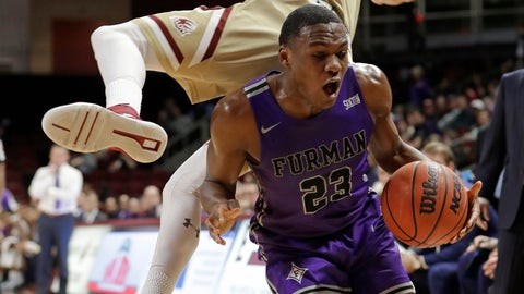 <p>               Furman's Jordan Lyons (23) reacts as Elon's Sheldon Eberhardt (20) flies into him in the first half of an NCAA college basketball game in Elon, N.C., Tuesday, Dec. 4, 2018. (AP Photo/Chuck Burton)             </p>