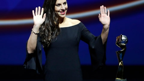 <p>               United States' Carli Lloyd waves as she stands by the World Cup trophy, during the women's soccer World Cup France 2019 draw, in Boulogne-Billancourt, outside Paris, Saturday, Dec. 8, 2018. (AP Photo/Christophe Ena)             </p>