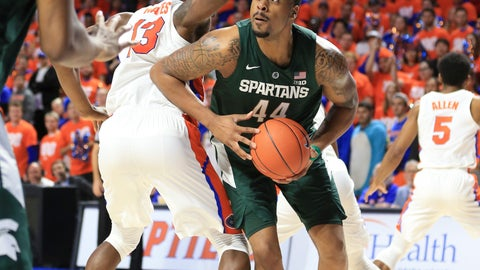 <p>               Michigan State forward Nick Ward (44) drives around Florida center Kevarrius Hayes (13) during the first half of an NCAA college basketball game Saturday, Dec. 8, 2018, in Gainesville, Fla. (AP Photo/Matt Stamey)             </p>
