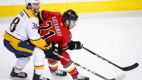 <p>               Nashville Predators' Ryan Hartman, left, checks Calgary Flames' Garnet Hathaway during the second period of an NHL hockey game in Calgary, Alberta, Saturday, Dec. 8, 2018. (Jeff McIntosh/The Canadian Press via AP)             </p>