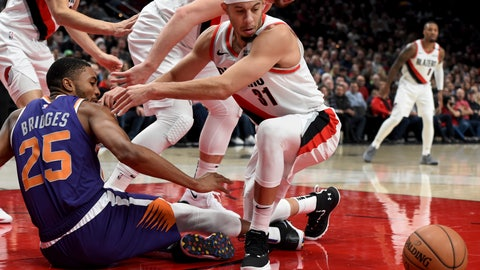 <p>               Phoenix Suns forward Mikal Bridges, left, and Portland Trail Blazers guard Seth Curry, right, battle for the ball during the first half of an NBA basketball game in Portland, Ore., Thursday, Dec. 6, 2018. (AP Photo/Steve Dykes)             </p>