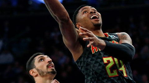 <p>               Atlanta Hawks guard Kent Bazemore (24) drives to the basket past New York Knicks center Enes Kanter during the first half of an NBA basketball game Friday, Dec. 21, 2018, in New York. The Hawks won 114-107. (AP Photo/Adam Hunger)             </p>