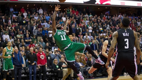 <p>               Boston Celtics guard Kyrie Irving (11) shoots with Washington Wizards guard Bradley Beal (3) nearby during the overtime period of an NBA basketball game Wednesday, Dec. 12, 2018, in Washington. The Celtics won 130-125. (AP Photo/Alex Brandon)             </p>