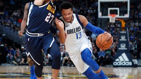 <p>               Dallas Mavericks guard Jalen Brunson, right, drives past Denver Nuggets guard Jamal Murray in the first half of an NBA basketball game Tuesday, Dec. 18, 2018, in Denver. (AP Photo/David Zalubowski)             </p>