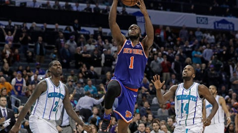 <p>               New York Knicks' Emmanuel Mudiay (1) drives past Charlotte Hornets' Michael Kidd-Gilchrist (14) and Marvin Williams (2) in overtime of an NBA basketball game in Charlotte, N.C., Friday, Dec. 14, 2018. (AP Photo/Chuck Burton)             </p>