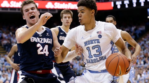 <p>               North Carolina's Cameron Johnson (13) dribbles the ball while Gonzaga's Corey Kispert (24) defends during the first half of an NCAA college basketball game in Chapel Hill, N.C., Saturday, Dec. 15, 2018. (AP Photo/Gerry Broome)             </p>