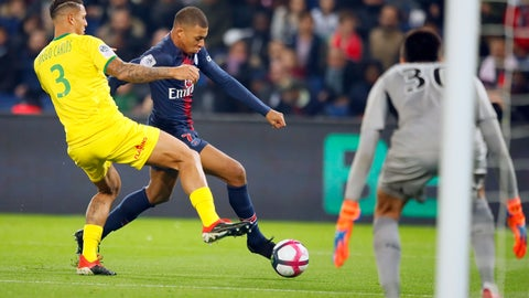 <p>               PSG forward Kylian Mbappe, center, vies with Nantes' Diego Carlos, left, during the League One soccer match between Paris Saint Germain and Nantes at the Parc des Princes stadium in Paris, Saturday, Dec. 22, 2018. (AP Photo/Francois Mori))             </p>