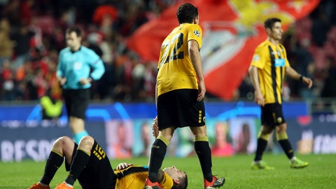 <p>               AEK's Ezequiel Ponce gives support to AEK's Uros Cosic lying in the pitch in dejection after defeat at the Champions League group E soccer match between Benfica and AEK Athens at the Luz stadium in Lisbon, Wednesday, Dec. 12, 2018. (AP Photo/Armando Franca)             </p>