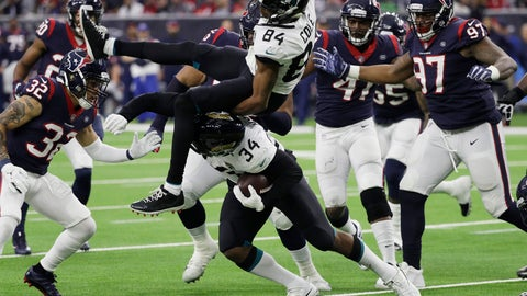 <p>               Jacksonville Jaguars running back Carlos Hyde (34) upends teammate Keelan Cole (84) as he runs against the Houston Texans during the second half of an NFL football game, Sunday, Dec. 30, 2018, in Houston. (AP Photo/David J. Phillip)             </p>