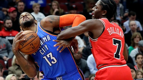 <p>               Oklahoma City Thunder forward Paul George, left, controls the ball against Chicago Bulls guard Justin Holiday during the first half of an NBA basketball game Friday, Dec. 7, 2018, in Chicago. (AP Photo/Nam Y. Huh)             </p>